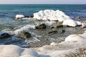 Ice Covered Stones On  Seashore