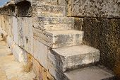 The Steps Of The Amphitheater. Stone Limestone And Marble. Ancient Antique Amphitheater In City Of H poster