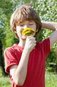 Teenager Enjoys Odors From Dandelions