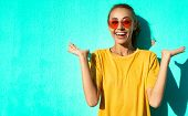 Close-up Portrait Of Fashionable Smiling Young Woman In Trendy Red Eyeglasses Posing Posing Emotiona poster