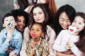 Lifestyle And People Concept: Young Pretty Diversity Nations Woman With Different Age Children Celeb poster