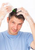 hair coloring man agains grey hair