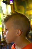 Portrait Of Young Boy With Mohawk