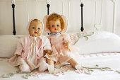 Two Vintage Dolls On Chenille Bedspread On Iron Bed