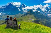Tourists Admire Eiger, Monch And Jungfrau Mountains From Summit Of Mountain Mannlichen, Popular View poster