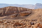 Scenic striped rocks in the Small Crater (Makhtesh Katan) in Negev desert, Israel