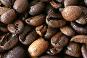 Dark whole coffee beans background