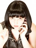 Young Brunette Talking To Phone