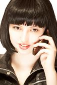Young Brunette Talking To Mobile Phone