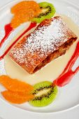Apple strudel with fruits and sauce