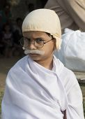 Young Boy Standing Dressed Up As Gandhi For World Record