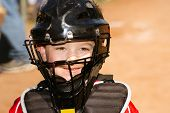 Portrait of child with catcher s equipment on during baseball game