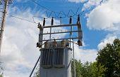 Transformer Substation Of High Voltage On Blue Sky Background