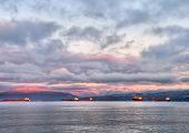 Sunrise With Transport Boats And Pink Mountains