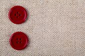 Red Buttons On The Old Clothes
