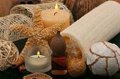 Spa concept  with aromatic candles, massage oil and loofah