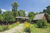 image of household farm  - Old Traditional Romanian Rural Household On A Beautiful Summer Day - JPG