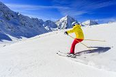 Ski, skier on ski run - woman skiing downhill, winter sport