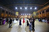MOSCOW - MAY 25: Different couples whirling in the dance under purple lights  at 11th Viennese Ball