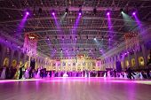 MOSCOW - MAY 25: Beautiful people under purple lights at 11th Viennese Ball in Gostiny Dvor on May 2