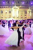 MOSCOW - MAY 25: Pairs in beautiful dress under purple lights  at 11th Viennese Ball in Gostiny Dvor