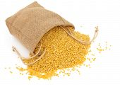 Mung dahl dried food ingredient in a hessian bag over white background.
