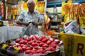 AMPANG - OCTOBER 9: A vendor sells religious prayer ornaments and paraphernalia at his stall at the