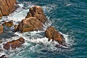 Stones In The Sea Deep Blue With Waves Beautiful Landscape