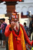 Holy sadhu Hindu man with painted face in Kathmandu