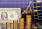 Uptrend Financial Chart, One-dollar Banknote, Stacks Of Golden Coins . Selective Focus