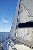 Yacht Sailing On The Lake In Sunny Day
