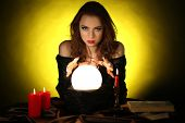 picture of witch ball  - Halloween witch on dark yellow background - JPG