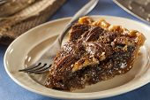 stock photo of pecan  - Homemade Delicious Pecan Pie for the Holidays - JPG