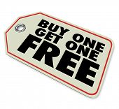 A price tag with words Buy One Get One Free to illustrate a special discount or clearance sale adver