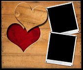 stock photo of two hearts  - Two instant photo frames on brown wooden wall with a hole in the shape of heart and red velvet background with roses flowers - JPG