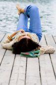 Woman Lying Near The River