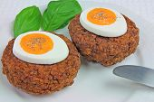 Two Meat Balls with Eggs and Basil