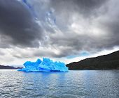 National Park Torres del Paine in Chilean Patagonia. Blue ice iceberg reflected in the lake Gray