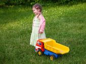 Girl with truck toy