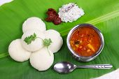 idli, sambar, coconut and lime chutney, south indian breakfast on banana leaf