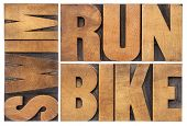 run, bike, swim - triathlon concept - isolated word abstract in vintage letterpress wood type