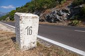 White Kilometer Stone Post On The Roadside In Montenegro