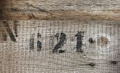 Close Up Texture Of Rough Uncolored Wooden Board With Number