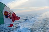 image of sea-scape  - view of Italian flag on the sea - JPG