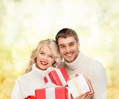 christmas, x-mas, winter, valentine's day, birthday, couple, happiness concept - smiling woman and m