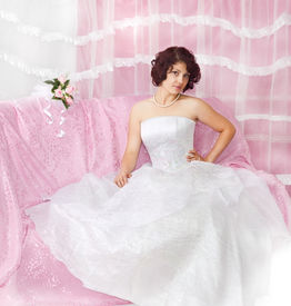stock photo of glans  - Portrait of beautiful  brunette bride on pink - JPG