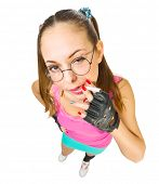 Funny schoolgirl with nerd glasses and cigarette  isolated