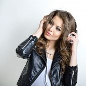 Young beautiful woman with headphones listening music. Teenager girl and music concept.