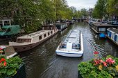 image of houseboats  - Traditional houseboats in a canal of Amsterdam - JPG