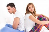 Upset Couple Sitting Separate In A Bed, Having Conflict Problem